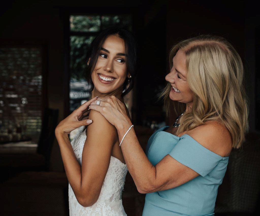 The bride and her mother have fun with her ring