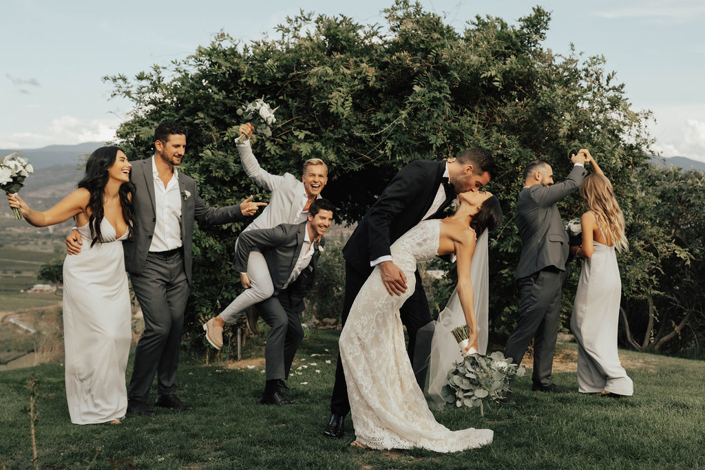 The bridal party celebrates in the apple orchard