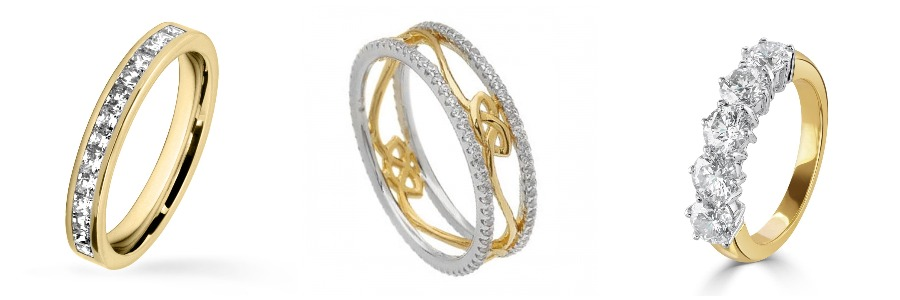 Three Eternity diamond rings of various sizes in both yellow and white gold