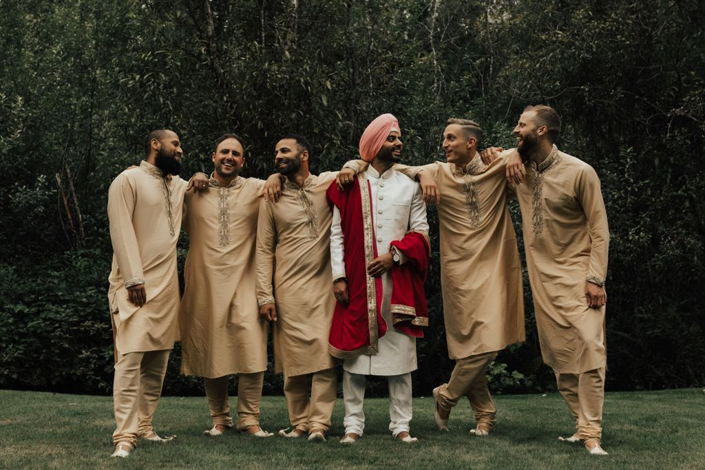 A group of men in Indian wedding attire
