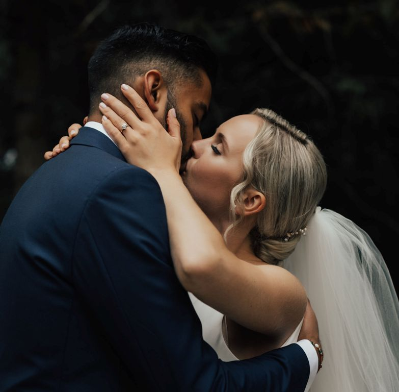 A couple kisses at their wedding