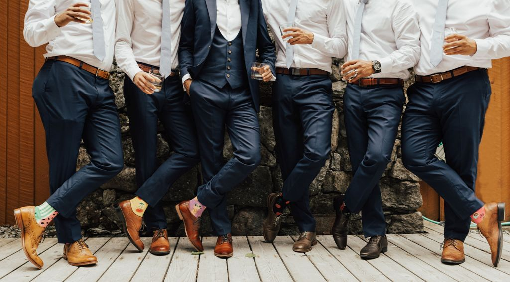 A group of men in blue pants and shoes